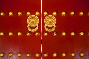 Chinese gate red doors with golden dragon heads knockers