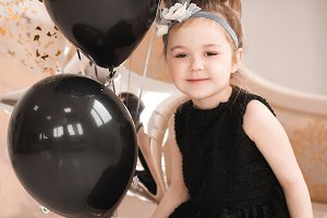 Girl with black balloons