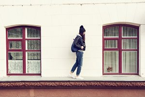 woman walking on cornice of house