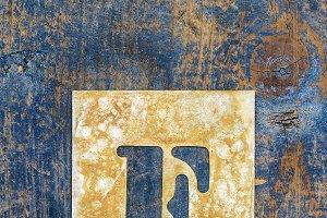 Metallic typography: letter F