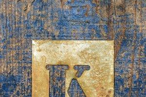 Metallic typography: letter K