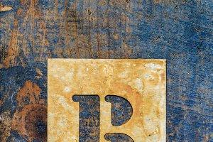 Metallic typography: letter R