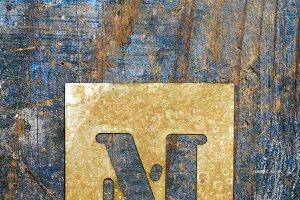 Metallic typography: letter M