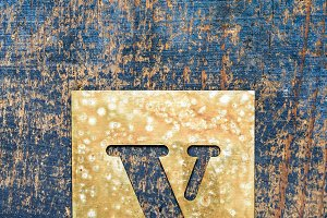 Metallic typography: letter V