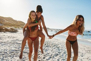 Joyful female friends on beach