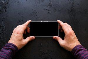 man looks in smartphone mockup