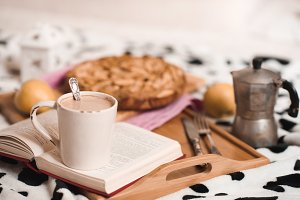 Cup of coffee and open book