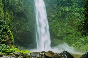 Amazing Nungnung waterfall, Huge Rocks in front, Bali, Indonesia