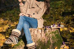 girl sitting on tree stump