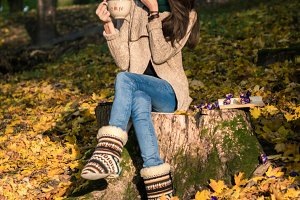 girl sitting on tree stump