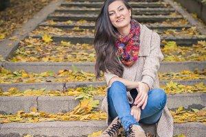 girl sitting on stone steps