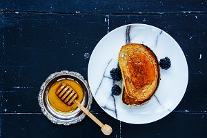 Toasts, honey, blackberries