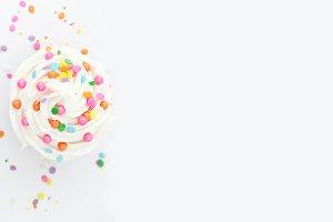 vanilla confetti cupcake with icing