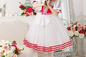 Pretty ballerina holding flowers