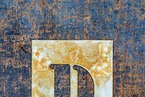 Metallic typography: letter D