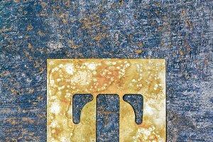 Metallic typography: letter T