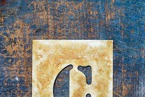 Metallic typography: letter C