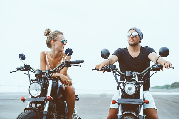 Young couple siting on motorcycles