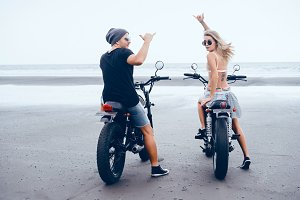 Couple posing on motorcycles