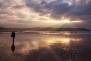 Woman Walking On The Beach in Devon