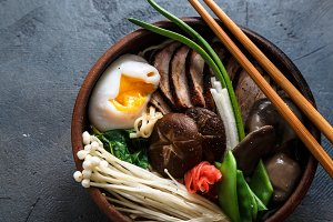 Mixed oriental mushroom stir fry with noodles soup and spring onion