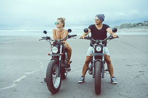 Hipster couple using motorcycles