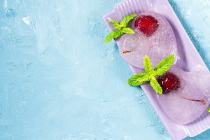 Summer background ice hearts cherries