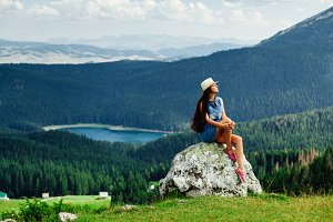 woman relax on peak of mountain