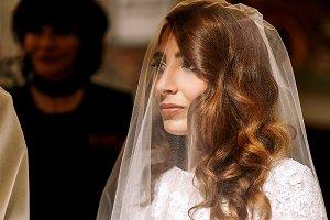 Gorgeous bride hidden under a veil