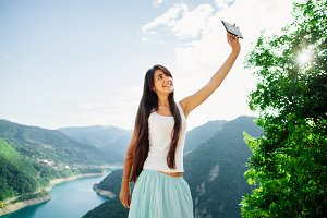 woman taking selfie and travel