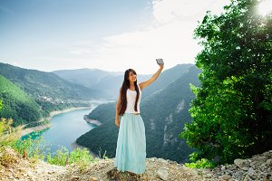 girl taking selfie and travel