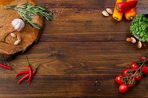 Fresh salad ingredients on wooden background