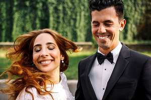 Bride and groom with closed eyes