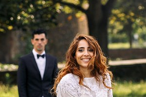 Gorgeous curly bride and groom
