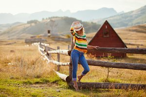 happy woman posing in cowboy hat