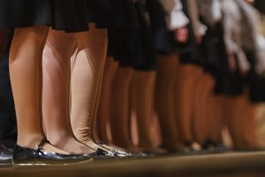 legs in pantyhose of girl - children choir - rehearsal of Academic Song
