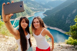 young Girls taking Selfie photo