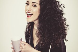 Studioshot of beautiful girl with a cup of coffee on white background