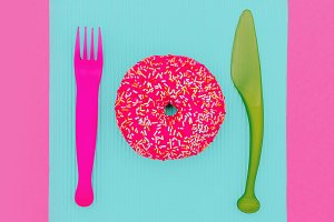 Donut on a pink background.