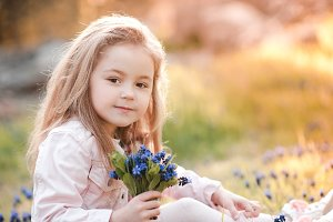 Cute kid with flowers