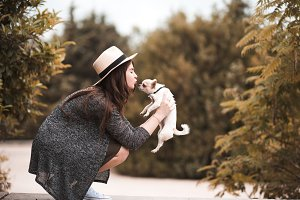 Stylish girl with dog