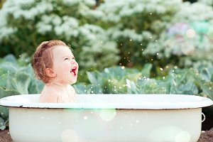 Baby bathing outdoors