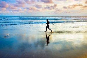 Jogging at the ocean beach