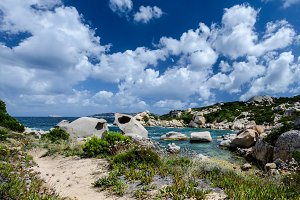 cloudy landscape and granit rocks on sardinia italy