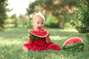Baby girl eating watermelon