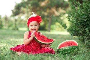 Baby girl eating melon