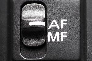 Lens autofocus button