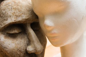 Two Sculptures Heads Background