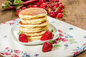 Pancakes with strawberries on plate