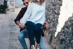 Smiling young couple on bike